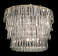 Decorative Arts, French, A Large Modern Baccarat Cut Crystal Five-Tiered Chandelier,.France, late 20th century. 36 h x 48 w x 24 d inches (91.4 x 12...