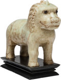 Asian:Chinese, A Large Chinese Hardstone Carved Lion Figure on Wooden Base. 14 h x19 w x 7 d inches (35.6 x 48.3 x 17.8 cm). ...