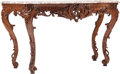 Furniture : Continental, A Continental Rococo Revival Carved Oak Console with Marble Top,19th century. 34-3/4 h x 62 w x 25-1/2 d inches (88.3 x 157...