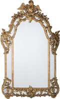Furniture : French, A Rococo Revival Carved and Giltwood Framed Overmantle Mirror ,19th century. 72 inches high x 47 inches wide (182.9 x 119.4...