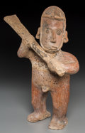Pre-Columbian:Ceramics, A Colima Large Standing Male with Club. c. 200 BC - 200 AD...