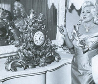 A Mae West Large and Ornate Mantle Clock, Circa 1860s     Movie/TV