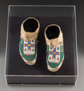 American Indian Art:Beadwork and Quillwork, A Pair of Sioux Beaded Hide Moccasins. c. 1900... (Total: 2 Items)