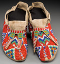 American Indian Art:Beadwork and Quillwork, A Pair of Sioux Beaded Hide Moccasins. c. 1915... (Total: 2 Items)