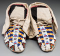 American Indian Art:Beadwork and Quillwork, A Pair of Sioux Beaded Cloth and Hide Moccasins. c. 1890... (Total:2 Items)