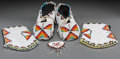 American Indian Art:Beadwork and Quillwork, A Pair of Plains Beaded Hide Moccasins with Matching Cuffs andOrnament. c. 1950... (Total: 5 Items)