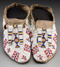 American Indian Art:Beadwork and Quillwork, A Pair of Sioux Beaded Hide Moccasins . c. 1890. . ... (Total: 2 Items)