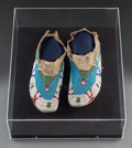 American Indian Art:Beadwork and Quillwork, A Pair of Sioux Beaded Hide Moccasins. c. 1910... (Total: 2 Items)