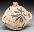 American Indian Art:Pottery, A Cochiti Polychrome Canteen. c. 1920. ...