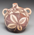 American Indian Art:Pottery, An Acoma Polychrome Canteen. c. 1920...