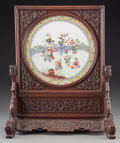 Asian:Chinese, A Chinese Famille Rose Porcelain and Carved Rosewood Table Screen,Qing Dynasty, first half 19th century. 17-1/4 h x 14-1/2 ...