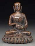 Other, A Tibetan Copper Alloy Figure of a Seated Luohan holding an Alms Bowl, 16th century. 7 h x 5-3/8 w x 4-3/8 d inches (17.8 x ...