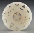 Asian:Chinese, A Chinese Carved White Jade Disc with Articulated Center, late QingDynasty. 2-1/8 inches diameter (5.4 cm). ...