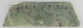 Asian:Chinese, A Chinese Neolithic Jade Axe Blade. 4-1/8 inches high x 13-1/8inches wide (10.5 x 33.3 cm). ...