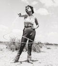 Photographs, Frank Worth (American, 1923-2000). Elizabeth Taylor with a lasso, on set of Giant, 1955. Gelatin silver, printed later. ...