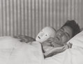Photographs, Berenice Abbott (American, 1898-1991). Jean Cocteau lying with the mask of Antigone, 1927. Gelatin silver, printed later...