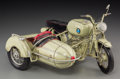 Decorative Arts, Continental:Other , A German Painted Tin Motorcycle and Sidecar Model Toy, 20thcentury. 6-3/8 h x 11-1/2 w x 8 d inches (16.2 x 29.2 x 20.3 cm)...