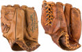 Baseball Collectibles:Others, Eddie Mathews and Lew Burdette Signed Baseball Gloves Lot of 2....