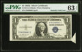 Error Notes:Attached Tabs, Fr. 1614 $1 1935E Silver Certificate. PMG Choice Uncirculated 63EPQ.. ...