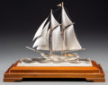 Silver Smalls, A Cased Sterling Silver Model of a Sailboat, 20th century. Marks:STERLING SILVER. 10-7/8 h x 10-1/2 w x 6-1/2 d inches ...