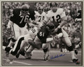 Football Collectibles:Others, Dick Butkus Signed Large Photograph. The Hall of Fame Chicago Bears bruiser recovers a fumble as fellow Cantonite Terry Bra...