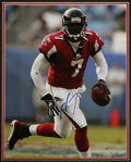 Football Collectibles:Others, Michael Vick Signed Large Photograph. Definitive photo of this thrilling quarterback in action is signed in 10/10 blue shar...