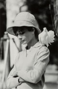 Photographs:Gelatin Silver, Terry O'Neill (British, 1938). Audrey Hepburn with Dove, St.Tropez, 1967. Gelatin silver, printed later. 30 x 19-3/4 in...