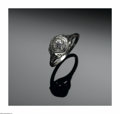 Jewelry, A GOLD AND DIAMOND LADY'S RING. The European-cut center stone weighing .33 carats set in 18k white gold. ...