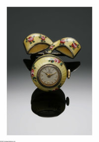 A SWISS ENAMEL PENDANT TIMEPIECE Bucherer, Switzerland  The egg-shaped pendent of silver with enameling, original dials...