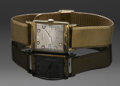 Clocks & Mechanical, A MEN'S GOLD WRISTWATCH. Longines Watch Company, New York. The gold men's wristiwatch with rectangular case, metal dial wi...