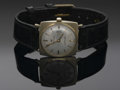 Clocks & Mechanical, A MEN'S GOLD AND LEATHER WRISTWATCH. Hamilton. The black leather band with 1.1in. wide square case with gold hands and das...