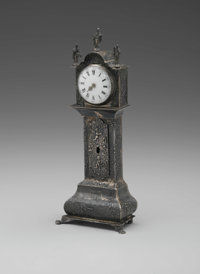 A MINIATURE GRANDFATHER CLOCK Maker unknown  The miniature silver grandfather flock with maritime scene to bottom region...