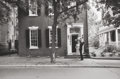 Photographs, Mark Shaw (American, 1922-1969). JFK in front of Georgetown house, 1961. Gelatin silver, 1963. 12-1/2 x 18-3/4 inches (3...
