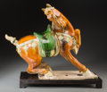 Asian:Chinese, A Chinese Sancai Glazed Pottery Prancing Horse on Stand, TangDynasty, circa 618-907 . 17 h x 21-3/4 w x 6-3/4 d inches (43....(Total: 2 Items)