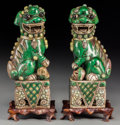 Asian:Chinese, A Pair of Chinese Famille Verte Porcelain Foo Lions with Stands,20th century. Marks: CHINA. 8-1/4 inches high (21.0 cm)...(Total: 2 Items)