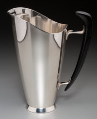 A Gorham Modernist Silver and Ebonized Wood Martini Pitcher, Providence, Rhode Island, circa 1955 Marks: (lion-anc