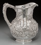 An S. Kirk & Son Co. Silver Repoussé Landscape Pitcher, Baltimore, Maryland, circa 1920 Marks: S. KIRK &a...