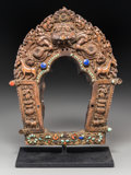 Asian:Other, A Tibetan Repoussé Copper Alloy Prabhamandala with InsetSemi-Precious Stones, 16th-17th century. 12 inches high (30.5 cm)....