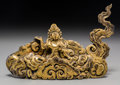 Asian:Other, A Mongolian Gilt Copper Alloy Deity in Clouds, 18th/19th century. 7-1/8 inches long (18.1 cm). ...
