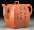 Asian:Chinese, A Chinese Yixing Pottery Teapot with Prunus Motif. Marks:Four-character artist's seal. 4-1/4 inches high (10.8 cm). ...