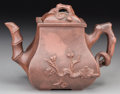 Asian:Chinese, A Chinese Yixing Pottery Teapot with Prunus and Pine Motifs. Marks:Six-character seal to the underside. 4 inches high (10.2...