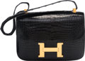 "Luxury Accessories:Bags, Hermes 23cm Shiny Black Crocodile Constance Bag with Gold Hardware. E Circle, 1975. Good Condition. 9"" Width x 7"" Height x..."