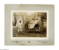 Antiques:Black Americana, Mounted Photo of Black Rickshaw Driver. A fascinating study on howone can humiliate a servant! A mounted photograph of a pa...