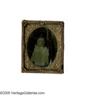 Photography:Tintypes, Black Baby Tintype. A post-mortem tintype of a small black baby in a casket with dark lining. When photography was new it wa...