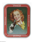 Advertising:Soda Items, 1950s Girl with a Bottle Coke Tray. Here we offer both variationsof this tray picturing a girl with red hair. One variety i...(Total: 2 )