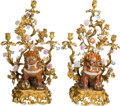 Decorative Arts, French:Lamps & Lighting, A Pair of Large Louis XV-Style Gilt Bronze, Porcelain, and CeramicThree-Light Candelabra with Sancta Foo Lions . 30-1/2 h x...(Total: 2 Items)