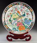 Asian:Chinese, A Chinese Famille Rose Enameled Porcelain Charger with Peacock and Peony Motif. Marks: Four-character impressed seal. 2-1/2 ... (Total: 2 Items)