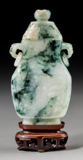Asian:Chinese, A Chinese Carved Jadeite Covered Vase with Archaic Motif and TwinRing Handles, Qing Dynasty. 6-1/8 inches high (15.6 cm) (v...