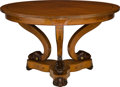 Furniture : French, A Charles X-Style Carved Fruitwood Center Table. 32-1/4 inches highx 54 inches diameter (81.9 x 137.2 cm). ...