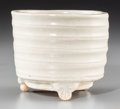 Asian:Chinese, A Chinese White Glazed Earthenware Ribbed Censer with Tripod Feet,Yuan Dynasty, circa 1271-1368. 3-1/2 inches high x 4-1/8 ...